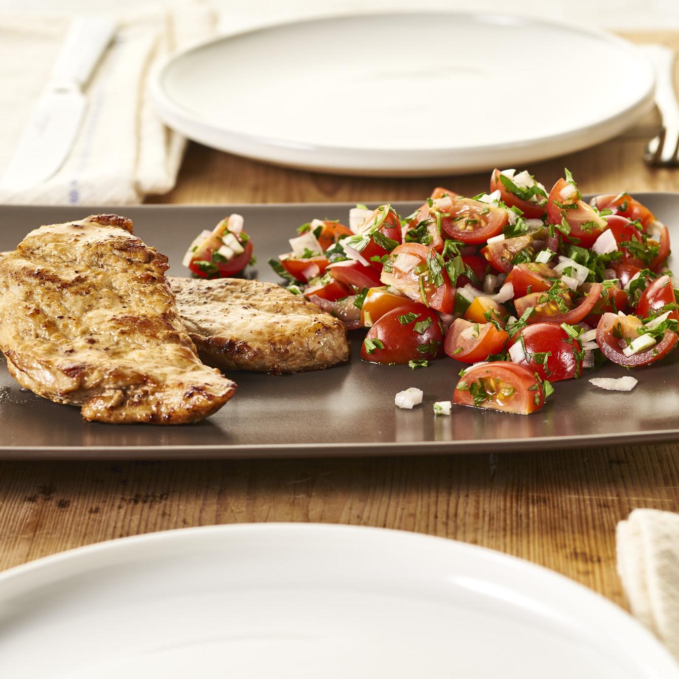 Varkensschnitzel met tomaten