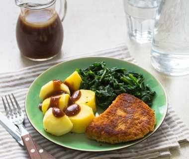 Verse spinazie met cordon bleu en aardappelen
