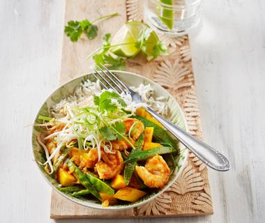 Gele curry met mango en garnalen